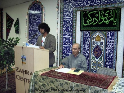 From left, Ahmad Rashid Salim reciting Qur'an, and Master of Ceremony Ali Pakfetrat.