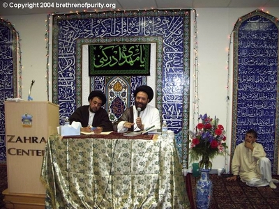 Syed Mudassir Ali Shah Moosvi, left, and Syed Fazil Hussain Mosavi. Seated on the floor is Syed Abu Muhammad Naqvi.