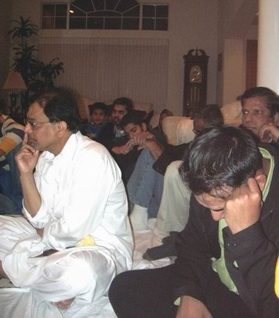 Dr. Mazhar Khan, left, and, behind him, Ali Abbas (and others), during an Islamic Halaqa in Morgan Hill, CA. Abbas has served in a variety of capacities at Shia Association of Bay Area (Saba Islamic Center), including president, director and advisor.