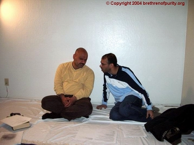 From left, Abbas Raza and Mohammad Alofi enjoying a conversation at the home of Ali Abbas in Fremont.