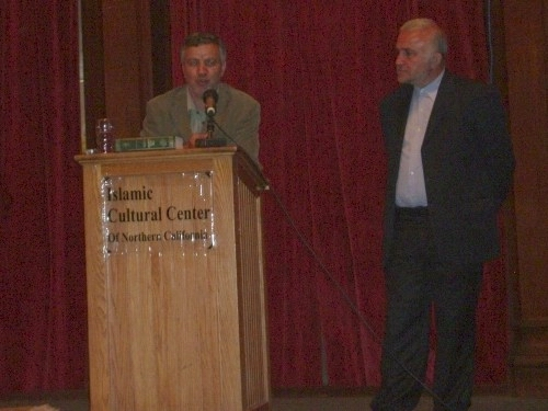 Former Iranian Minister of Culture and Islamic Guidance Seyyed Ata'ollah Mohajerani, left, giving a lecture at the Islamic Cultural Center of Northen California (ICCNC). To the right is the president of ICCNC.