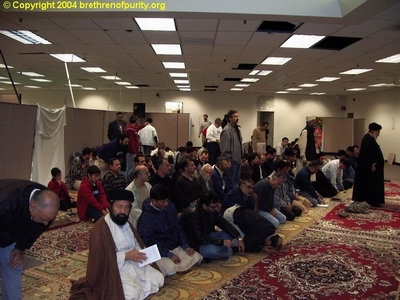 First from right, Seyyed Mojtaba Beheshti leading the prayers. Second from left is Syed Qamar Hassani (also wearing a black turban).