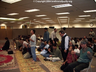 From left, the senior member of Saba Islamic Center Shuja Yezdi standing in prayer. Yezdi functions as a photographer during SABA events.