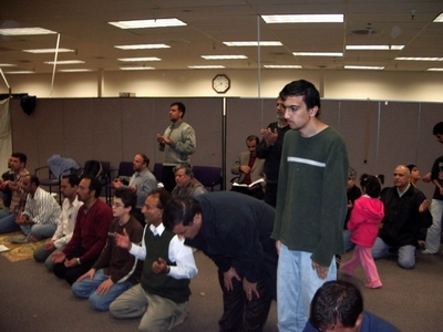 Sajjad Mir, first row, fourth from right, praying. Sajjad Mir is the Chairman of Shia Association of Bay Area (Saba Islamic Center), Vice Chair of the Islamic Council of Northern California (ICNC), and President and CEO of Hastest Solutions, Inc.