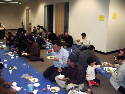 Sayed Rizvi, center from center, eating the Iftar meal. Sayed Rizvi a prominent member of Shia Association of Bay Area (Saba Islamic Center). Rizvi is also the president of Pascal Engineering.