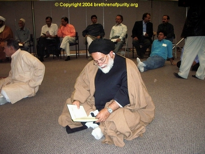 The mullah Mojtaba Beheshti, front, reading. Mojtaba likes to be kool and wear his turban beret style. Seated in the back are several senior SABA members, including Chairman Sajjad Mir and the SABA co-founder and long-term trustee Muzaffar