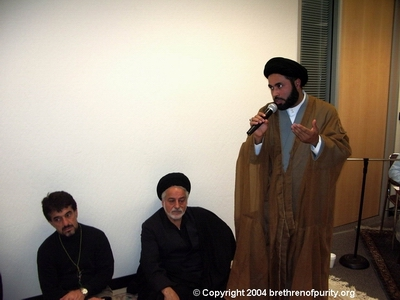 Inside Saba Islamic Center: Nabi Raza talking. Seated are Seyyed Mahmoud Sedehi, right, and Saeid Mohajer.