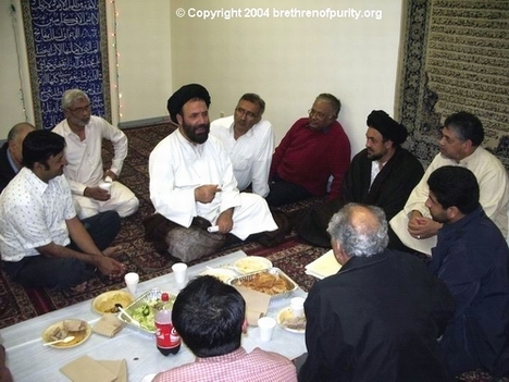 Syed Fazil Mosavi, center, with Age of Appearance conference guests gathered around him after dinner at Azakhana-e-Zahra, PBUH, in Milpitas (South Bay Area), California. He had joined the local congregation during Ramadan 2004 and 2005.