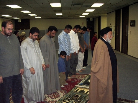 Mullah Mojtaba Beheshti, right, leading the Maghrebain prayers at the Iraqi Community Association in Silicon Valley.