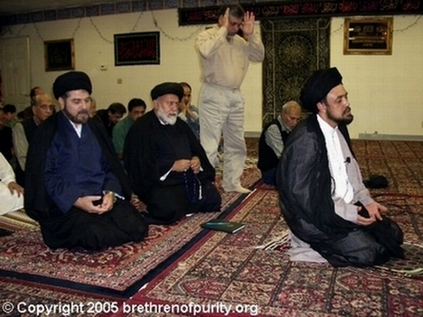 Syed Mudassir Ali Shah Moosvi, first from right, leading prayers at Azakhana-e-Zahra in Milpitas, California. Also in the picture, from left, the Shia mullahs Syed Ehtisham Zaidi and Seyyed Mojtaba Beheshti (jailed and then deported from the United States in 2007 due to Green Card fraud). Standing is the prominent Bay Area Shia community member Syed Abu Mohammad Naqvi.