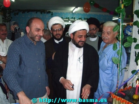 Sheikh Mohamad Khatoun, center, cutting the Hajj completion celebration ribbon.